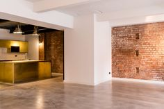 Riflemaker is a pre-war building, once the home to some of Birmingham's original gunsmiths. It was converted in 2014 into six through-floor loft apartments. Brick Interior, Reuse Recycle, City Living, Exposed Brick, Birmingham, Repurposed, Gun, Garage Doors, Industrial