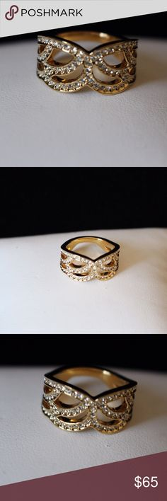 Swarovski Gold Petal Ring Swarovski gold tone ring.Thick band with petal designs covered in crystals.Stamped with Swarovski swan.Size 7.No trades/off-Posh transactions.Reasonable offers welcome! Swarovski Jewelry Rings