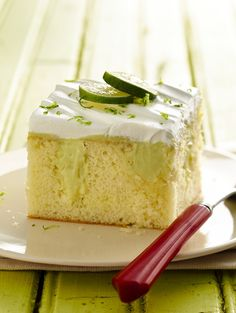 Inspired by Key lime pie, this refreshingly easy poke cake is a sweet-tart delight. No one will ever notice it's been lightened up with fat-free yogurt, fat-free sweetened condensed milk and low-fat whipped topping!