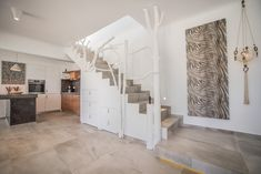 In Villa Sole we have used creativity in our decoration. As an example, the staircase leading to the two bedrooms on the floor, has been done with driftwood painted white. Two Bedroom, Bedrooms, Vacation Homes For Rent, Greek Design, Staircase Design, Luxury Villa, Beautiful Islands, Driftwood, Creativity