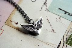 with wings. heart locket necklace. silver ox