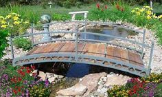 I used to pass by a landscape business, who had a stunning little wooden bridge feature for all to see. I fell in love with it, and it would most definitely be a feature in my Dream house's garden! <3