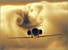 """Amazing cloud """"downwash effect"""" forms around a passing Cessna airplane."""