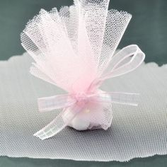 Pink colored tulle circles bomboniere packaging