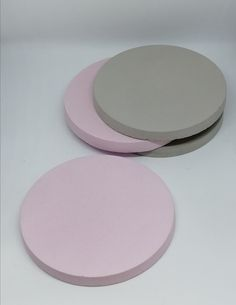 Pink and grey concrete coasters