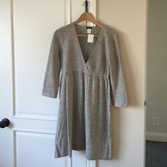 JCrew gray sweater dress JCrew gray sweater dress. 3/4 sleeves. V-neck.  Wool. Size medium. Never won. New w tags J. Crew Dresses