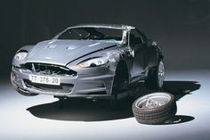 When the stunt team tried to flip James Bond's Aston Martin DBS in 'Casino Royale,' they found the car too stable to be overturned by an ramp. In their last attempt they fitted the DBS with a gas cannon and ended up rolling the car a total of 7 times, Used Aston Martin, Aston Martin Cars, Vegas Birthday, Bond Cars, Casino Royale, Car Brands, James Bond, Stunts, Cannon