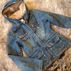 """Denim fleece lined jacket The is denim jacket is lined with fleece. Super thick. Two small pockets on the chest, two at the waist. Zipper and button closure. Hooded. Length: 24"""", bust: 19"""", sleeve length: 24.5"""". Gently used. Old Navy Jackets & Coats Jean Jackets"""