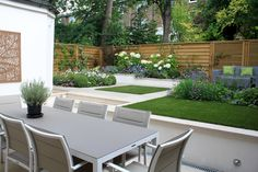 The brief for this project was to update the garden design and introduce more interest. The rotten fencing and decking needed to be replaced, while keeping a feeling of openness in the small garden.