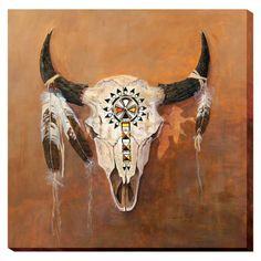 Painted skull, feathers, and beads adorn a classic bison momento of the west. The Wrapped Canvas Collection offers the look and feel of an original painting at a fraction of the cost. Arrives ready to
