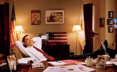 Senator Barack Obama (with Lincoln & King Photos in  the background) in his Capitol office.  www.vanityfair.com