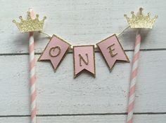 A personal favourite from my Etsy shop https://www.etsy.com/listing/269283446/crown-cake-banner-one-cake-banner-cake