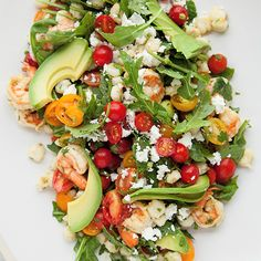 Shrimp Salad with Hominy, Arugula and Lime | With similar ingredients you'd find wrapped up in taco, this brightly colored shrimp salad is light but very much satisfying. Enjoy with chips and beer on a hot day.