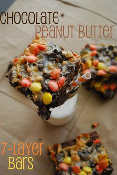 Chocolate peanut butter 7-layer bars - perfect for a Halloween party! - I will use devil's food cake mix and a can of pumpkin (instead of a stick of butter) for the base.  Gotta make it healthy where no one will notice!  :o)