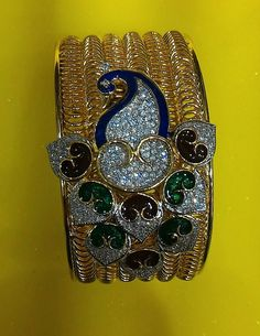 PEACOCK HAND BRACELET IMITATION JEWELLERY. LIMITED STOCK. ITEM CODE=128. FREE SHIPPING IN INDIA. FOR ORDERS, INQUIRY ,KINDLY MAIL OR WHATSAPP US ============MAIL AT=gloriousfashionpoint@gmail.com ===== WHATSAPP NO +91 73591 37568 ============== OR MESSAGE INBOX. PLEASE LOOK AT THE BELOW LINK FOR VIEWING OUR ALL COLLECTION