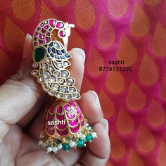 Stunning silver jumkhi with gold polish. Earrings studded with multi precious stones. Jumkhi with peacock design at studs. Diamond Earrings Indian, Gold Jhumka Earrings, Gold Earrings Designs, Gold Jewellery Design, Ear Jewelry, Pendant Jewelry, Gold Jewelry, Wedding Jewelry, Ear Chain
