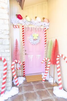 Gingerbread House Door Decor - cute way to decorate your door from Aww Sam. Gingerbread Christmas Decor, Candy Land Christmas, Retro Christmas Decorations, Whimsical Christmas, Christmas Porch, Christmas Holidays, Pink Christmas Lights, Lollipop Decorations, Vintage Pink Christmas