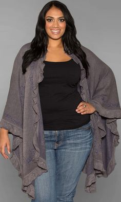 A lightweight, warm and cozy knitted plus size poncho. Over-sized with lots of room to wrap yourself in. Accented with a ruffled edge and available in earth tone shades.