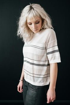 Contrast is the name of the game in this deliciously soft tee that features opaque and semi-sheer stripes, strategically placed to cover all the goods and create a very flattering silhouette. Elbow-le