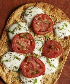 Photo of Tomato-Basil Flatout Thin Crust Pizza...love Flat out's flatbread.  I use it in lieu of bread. I cut one in 1/2 and it's only 45 calories and still makes for a filling wrap...or pizza. :)