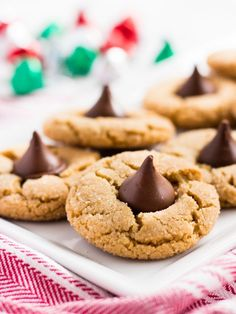 This peanut butter blossoms recipe makes the best Christmas cookies. They are so easy to make with Hershey's Kisses. | www.ifyougiveablondeakitchen.com