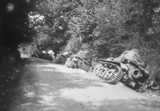 https://flic.kr/p/23D6XgG | 1940, France, Une colonne de chars français Renault R35 abandonnés et probablement poussés dans le fossé par les allemands afin de facilité le passage des troupes