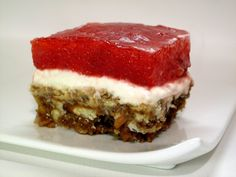 Utah: Jell-O Pretzel Salad: Jell-O is the state snack of Utah, and while there are a myriad of ways to eat the jiggly snack, this Jell-O pretzel salad is an intriguing salty and sweet dessert. It features layers of crushed pretzels, cream cheese, and a berry Jell-O.  Source: Victoria Belanger for The Jello Mold Mistress of Brooklyn