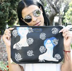 Do you have your #ElodieBlandaElena clutch yet? Get your custom #art turned #fashion piece at #ElodieK or www.elodiek.com today.  #SamiMiro