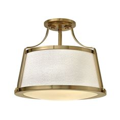 This Elstead Charlotte Semi Flush Ceiling Light in Brushed Caramel is an updated traditional design featuring a richly textured off-white fabric shade captured by wide solid metal