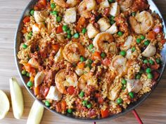 Pour me some sangria. Traditional paella with chicken, shrimp and chorizo