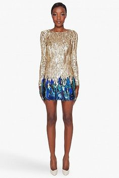 MATTHEW WILLIAMSON-LIQUID SEQUIN DRESS $4375.00  Hand-woven fitted gold sequin mini dress. Gold and blue sequins degrade into hand-dyed blue ostrich feathers at skirt. Long sleeves. Crewneck.