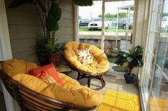 Papasan porch in yellow houseboat.  I love Papasan chairs.
