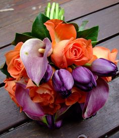 orange roses and purple tulips. Although I think my date is beyond tulips... perhaps purple orchids?