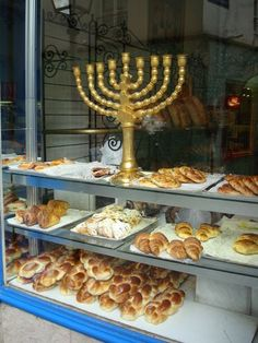 Le Marais, Paris - Shalom (not an every week menorah, a hannukiah specifically for Chanukah--how grand to have one that size in your bakery window <3)
