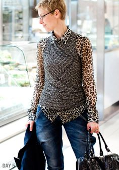 Layered knit top over a blouse.