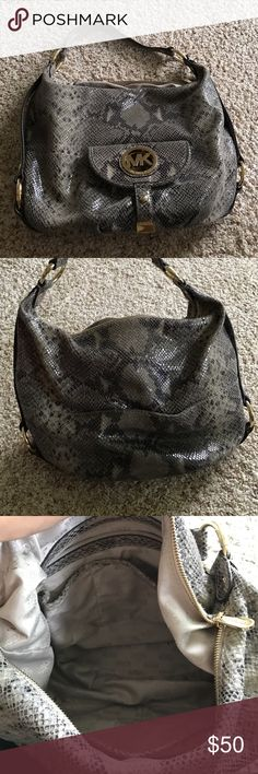 Michael Kors purse Stylish purse in snakeskin pattern and pretty gold accents. Plenty of space with pockets but not too big. Great everyday purse. Few stains on inside lining, otherwise perfect. Comes with original dust bag. KORS Michael Kors Bags Shoulder Bags