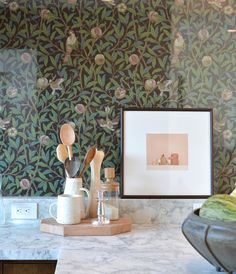 This was such a beautiful detail and brilliant idea, the use of the William Morris bird & pomegranate wallpaper behind glass as a backsplash.