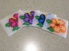 Beautiful set of 4 flower coasters made from Perler Beads. Approximately 15 cm by 10 cm.