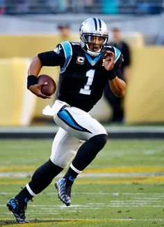 Quarterback Cam Newton #1 of the Carolina Panthers runs with the ball against the Denver Broncos during Super Bowl 50 at Levi's Stadium on February 7, 2016 in Santa Clara, California.