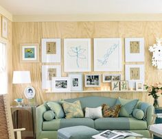 Plywood is usually the sign of a work in progress, but as this living room proves, it doesn't have to be. For an inexpensive way to cover your walls, you could consider using the material as an off-beat option... (I think it would be a good attractive alternative to tongue and groove walls inside a tiny house - particularly if you play with the stain colours a little bit. -RB)