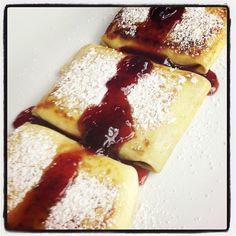 Cream cheese blintzes with strawberry sauce. Oh Yeah!