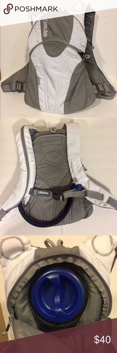 Camelback Sno Angel hydration pack Camelback Sno Angel backpack with bladder and straw with insulated sleeve. Low profile this pack is perfect for skiing or snowboarding and is great for runs and hikes on these cold winter days. White and gray, excellent condition, barely used, mouthpiece has been boiled. camelback Bags Backpacks