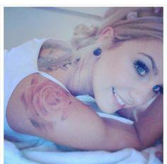 Slight pink rose tattoo
