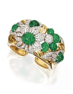 18 KARAT GOLD, EMERALD AND DIAMOND CUFF BRACELET, TRABERT & HOEFFER MAUBOUSSIN, CIRCA 1940. The cuff-bracelet of bombé form, designed with large flowerheads, leaves and buds, set with eight cabochon emeralds and numerous round and single-cut diamonds weighing approximately 11.50 carats, internal circumference 7½ inches, signed Trabert & Hoeffer Mauboussin.