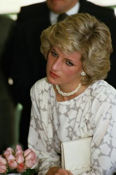 Princess Diana wearing Jasper Conran looks thoughtful during a visit to the Molfetta Deaf School in Bari April 1985