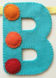 'B' of spotty 'Happy Birthday' hand sewn banner