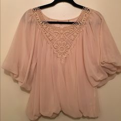 Nude Blouse This blouse features lace detailing in the front. Tops Blouses
