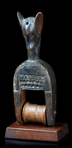 Africa | Heddle pulley from the Guro people of the Ivory Coast | Wood; dark brown patina. Complete with bobbin.