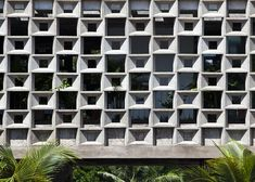 Binh Thanh House in Ho Chi Minh City by Vo Trong Nghia and Sanuki + Nishizawa with hollow concrete-block walls, a spiral staircase and balcony gardens. Concrete Block Walls, Concrete Facade, Concrete Design, Facade Architecture, Contemporary Architecture, Facade Design, House Design, Foyer Design, Breeze Block Wall
