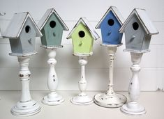 Great use of candle sticks and birdhouses. Spray and shabby chic the candle sticks, and hot glue the birdhouse on top = adorable! #decorativebirdhouses